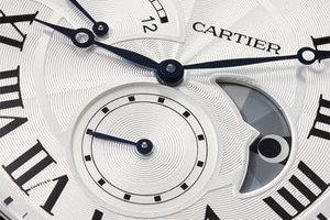 卡地亚大日历逆跳指示双时区昼夜显示腕表