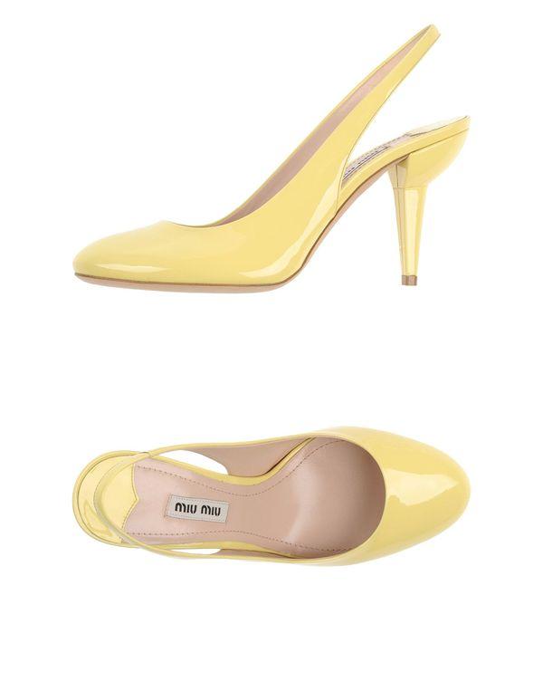 浅黄色 MIU MIU 高跟鞋