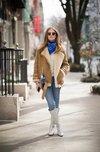 皮毛一体外套称霸街头 御寒又时髦
