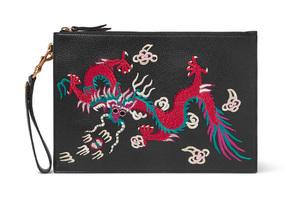 盘在意大利皮革工艺上的东方龙刺绣